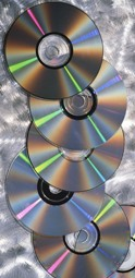 CDs on brushed steel background