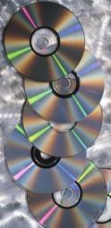CDs on brushed steel background