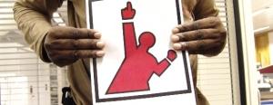 Hand holding UKG logo printout
