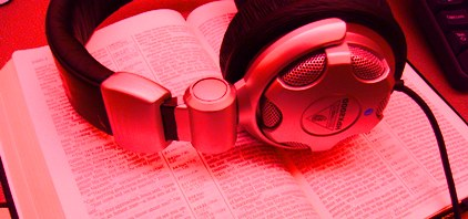 Bible and head phones (red tint)